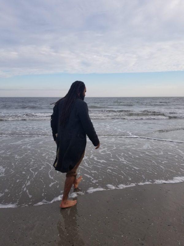 Amani Will walking on a beach